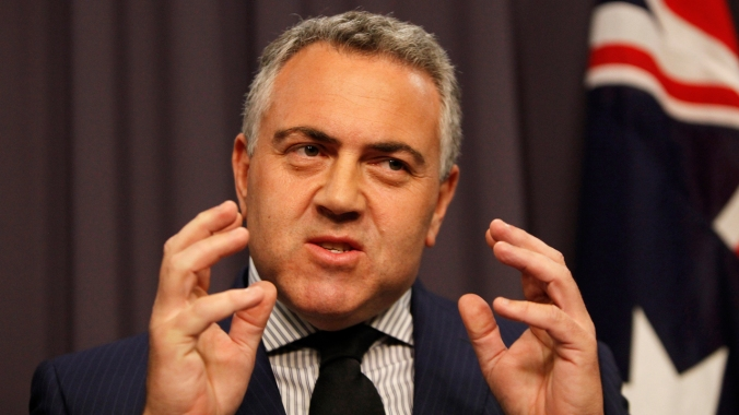 Treasurer Joe Hockey during a press conference at Parliament House in Canberra, Wednesday, Dec. 4, 2013. (AAP Image/Daniel Munoz) NO ARCHIVING